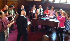 Ledell (in pink) conducting the PSUMC Gospel Choir/ Don accompanying, Easter, 2015