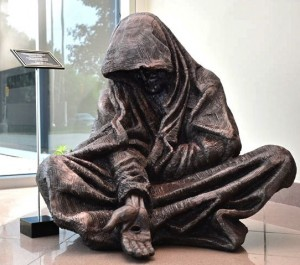 """Whatsoever You Do"" sculpture of begging Jesus by Timothy P. Schmalz,"