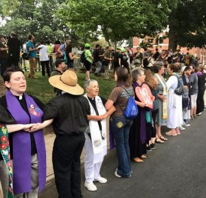 Clergy and lay people sang to counter white supremacists in Charlottesville, VA, summer 2017